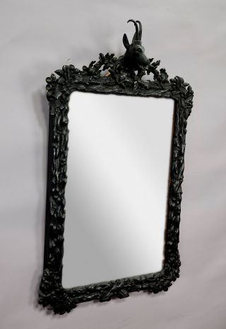 A Large Black Forest Wooden Carved Mirror With Chamois Head photo