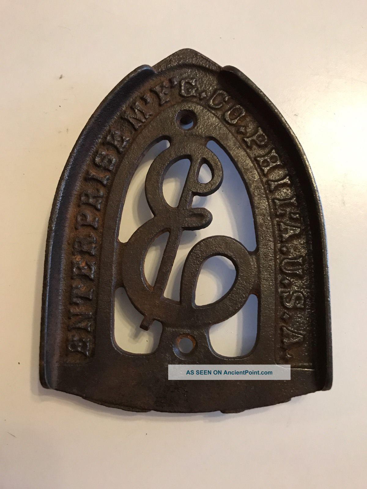 Antique Cast Iron Sad Iron Trivet Enterprise Mg Co Philadelphia Trivets photo