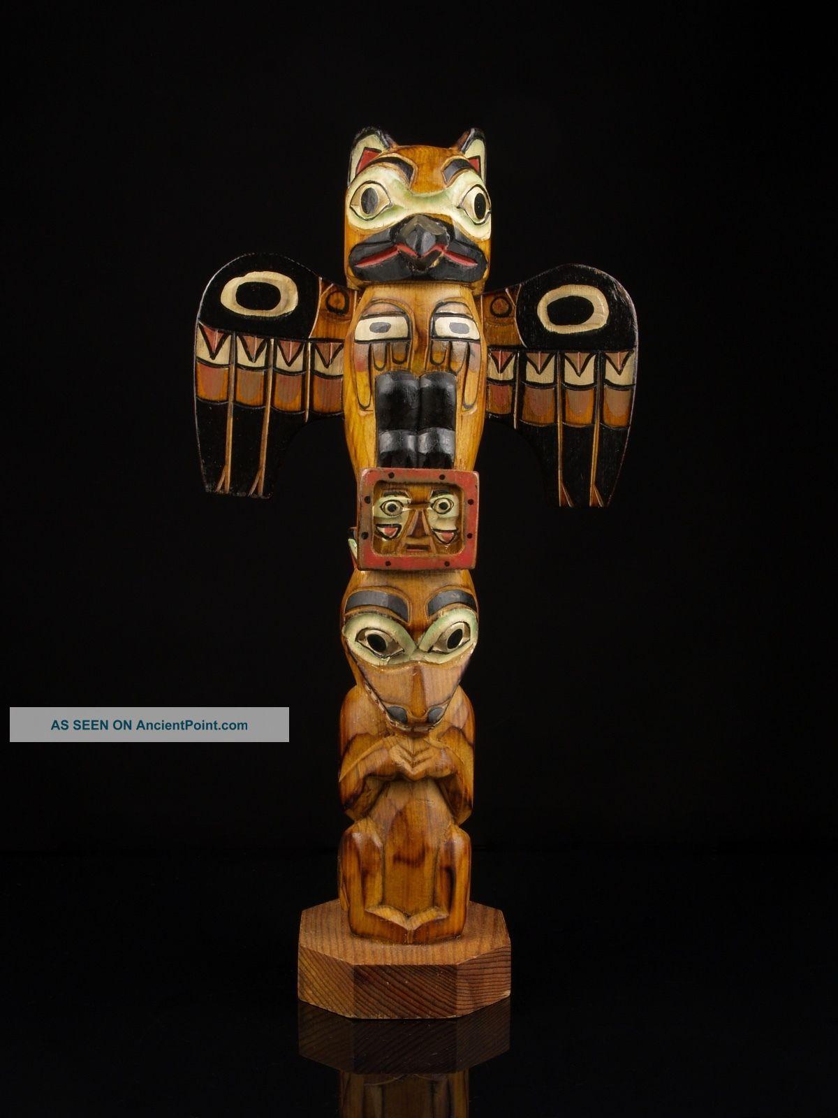 A Vintage Alaskan Carved Wood Totem Pole,  Signed