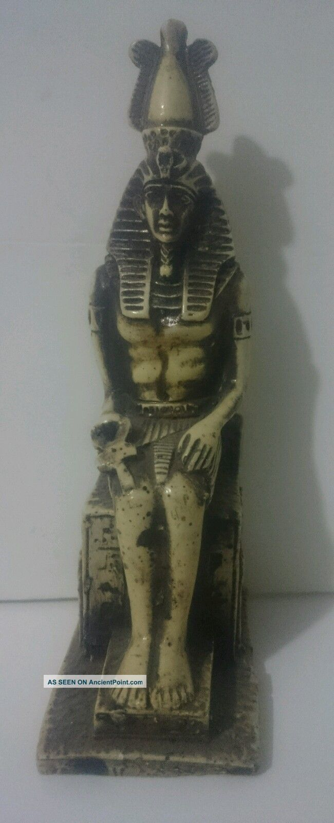 Ancient Egyptian Statue Of King Ramses Ii Sitting Holding Ankh Egyptian photo