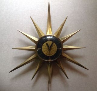 Vintage Starburst Electric Wall Clock Classic Mid Century Eames Era Style photo