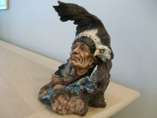 A Native American Indian Chief With Eagle Figurene photo