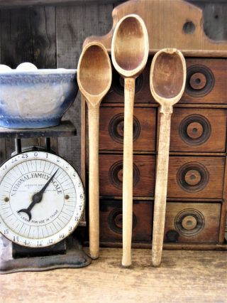 3 Large Antique Wooden Stirring Spoons Surface photo