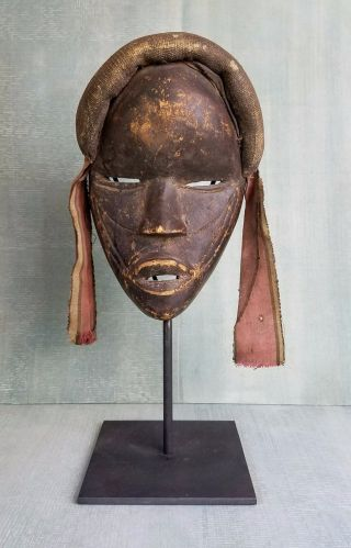 Antique Dan Tribe Mask With Woven Fabric Crown Surround And Hanging Cloth photo
