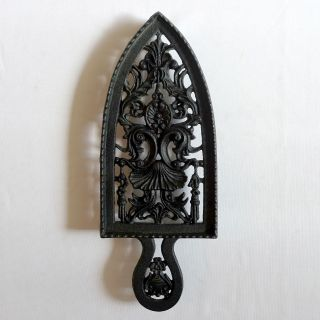 3 Cast Iron Spade Shaped German Trivets With Interesting Details photo