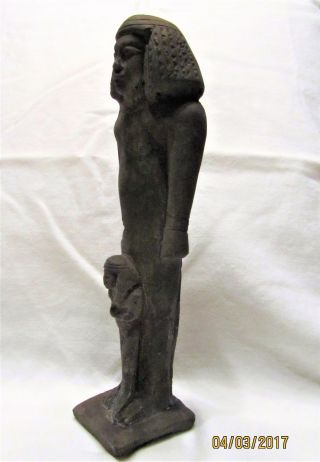 Ancient Egyptian Artifact Statue Isis With Child Horus photo