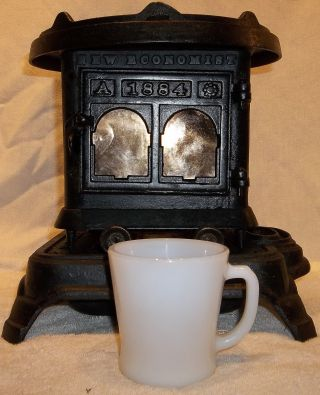 Antique Economist 1884 Miniature Cast Iron Kerosene Heater Stove Perry & Co. photo