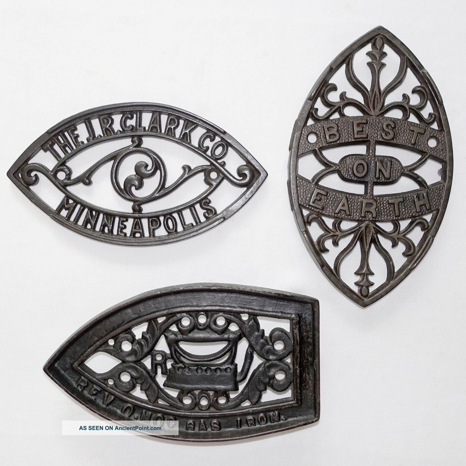 Four Cast Iron Sad Iron Stands Trivets: Clark,  Best On Earth,  Revo.  Noc & Clefton Trivets photo