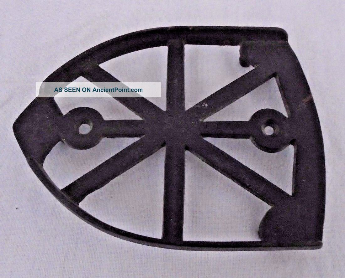 Vintage Sad Flat Iron Rest Trivet Trivets photo