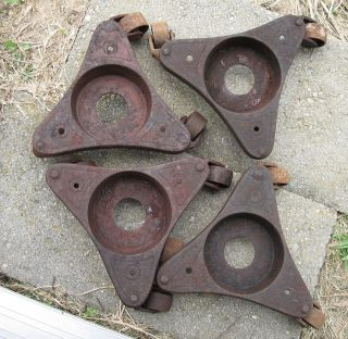 4 Antique Cast Iron Stove Piano Etc Rollers The Davis Company Dubuque Iowa photo