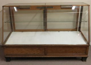 Antique Oak Slant Front Lighted Showcase W/ Cast Iron Feet Bakers Display Case photo
