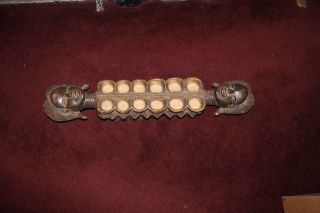 Antique African Mancala Hand Carved Gameboard - Tribal Women Faces - Footed - Museum photo