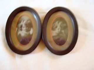 Antique Vintage Victorian Pair Oval Pictures Of Cupid Awake & Asleep Dated 1897 photo