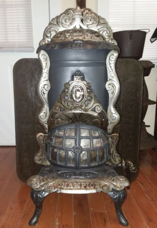 Antique Champion No.  14 Gas Parlor Stove With Antique Floor Plate photo