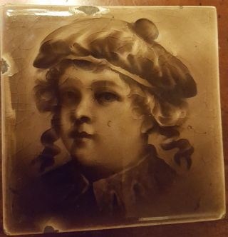 A.  E Tile Co.  Child ' S Face.  3