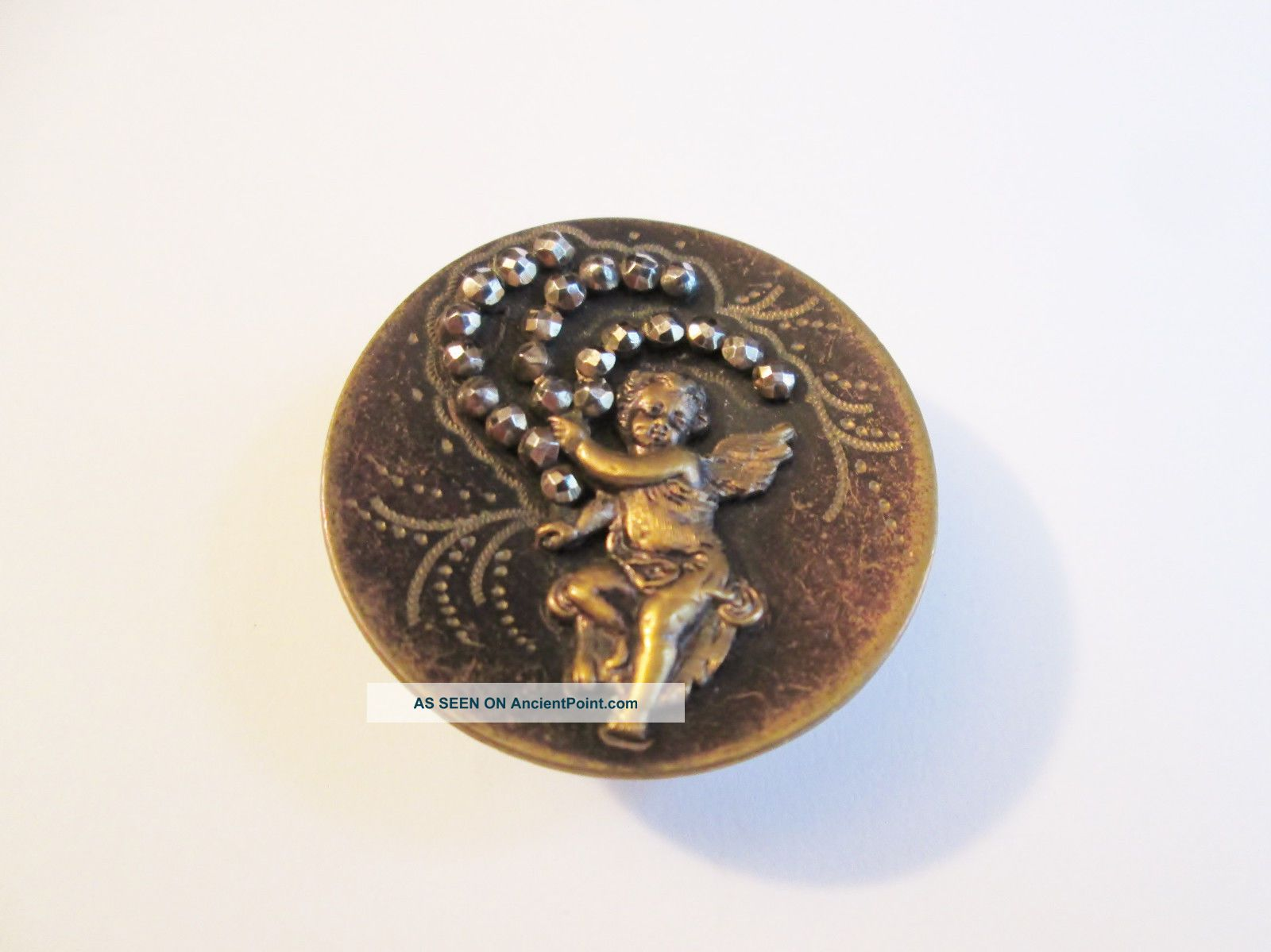 Interestinglarge Victorian Btn Cupid/cherub Holding Three Strands Of Cut Steels Buttons photo
