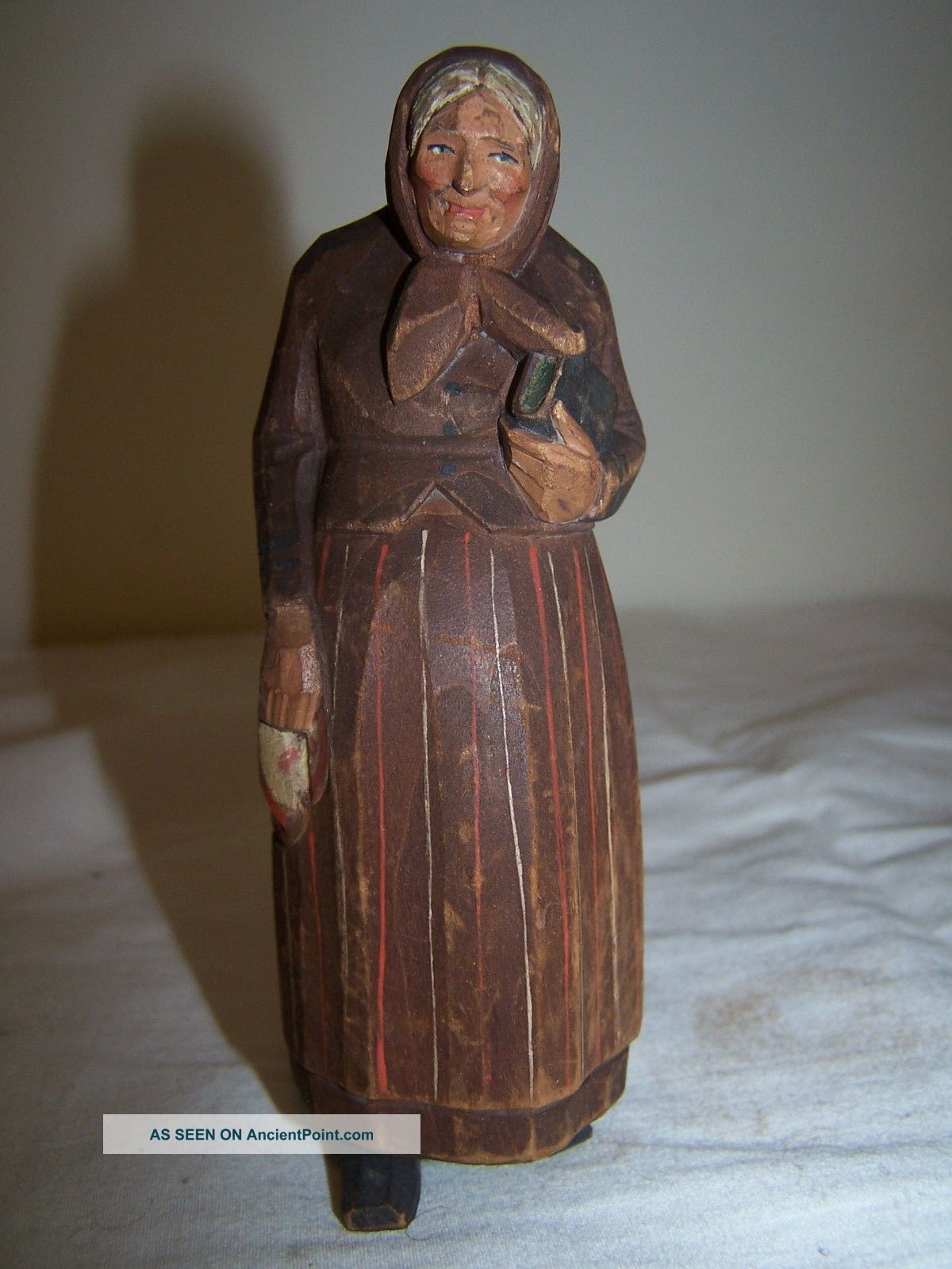 Swiss Wooden Carved Painted Woman Carrying Bible And Holding Handkerchief Carved Figures photo