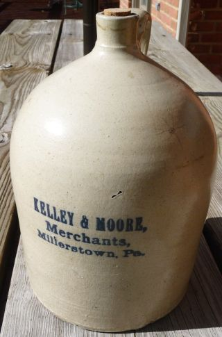 Vintage Kelley & Moore Merchants Millerstown,  Pa 1 Gallon Crock Jug Blue Letters photo